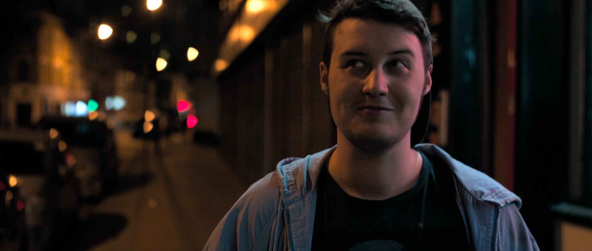Ink Asher Hemp as Orin on the street at night